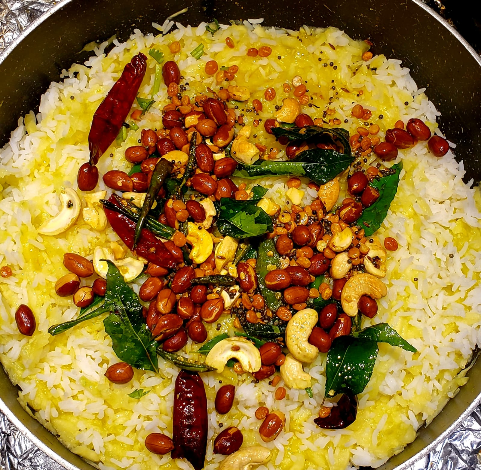 Tampered seeds are transferred to rice & grated mango mixture to make tasty raw mango rice recipe