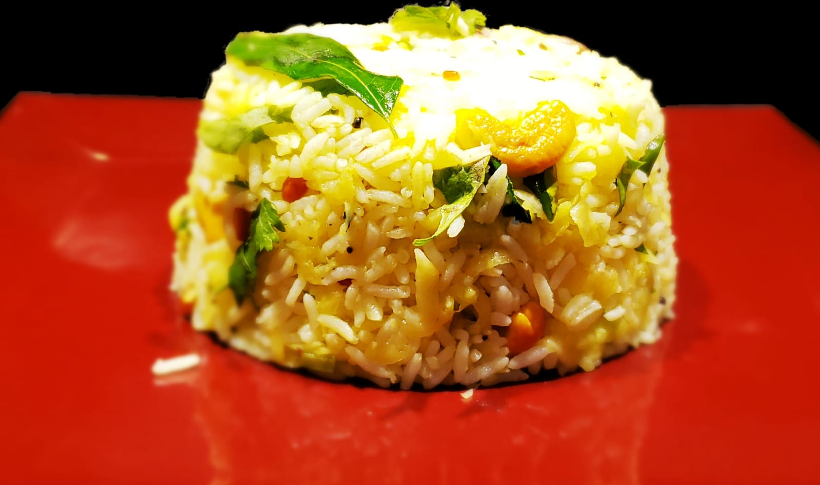A must try raw mango rice served in a plate
