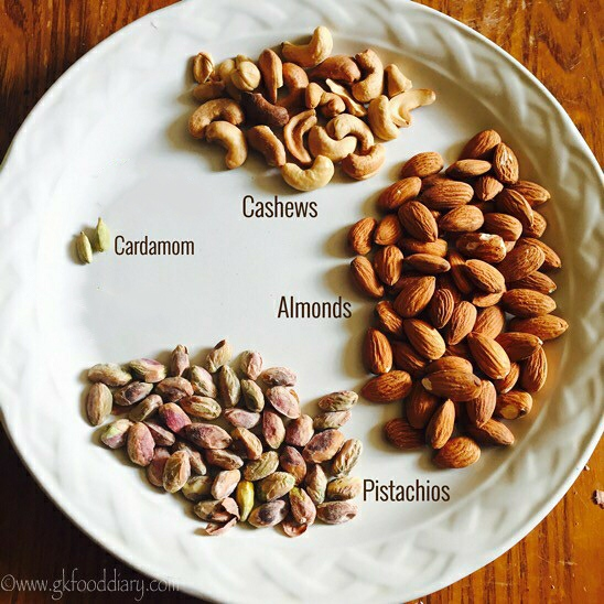 Cardamom, cashew, almonds & pistachio in a plate for home-made protein powder for kids
