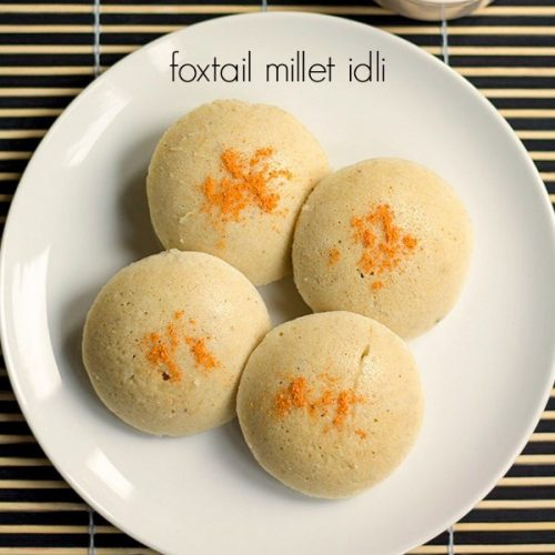 Foxtail millet idly served in a white plate with grated carrot on the top