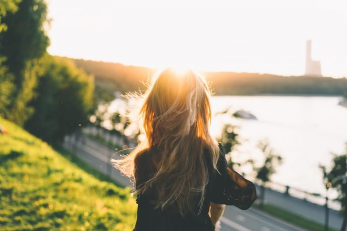 Woman enjoying Sunrise